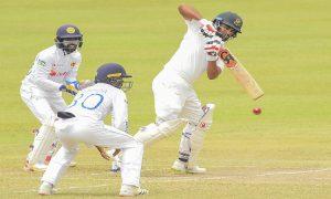 Tamim Iqbal (R) plays a shot-