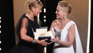 CANNES, FRANCE - JULY 17: Sharon Stone (R) gives Julia Ducournau (L) the Palme d'Or 'Best Movie Award' for 'Titane' during the closing ceremony of the 74th annual Cannes Film Festival on July 17, 2021 in Cannes, France. (Photo by Andreas Rentz/Getty Images)